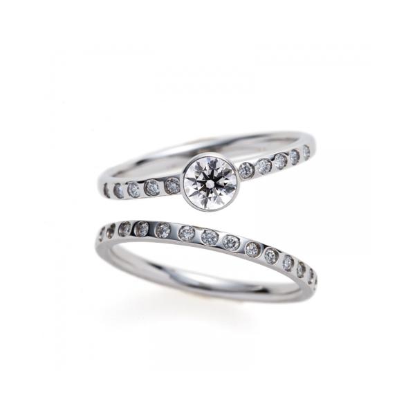 新潟で思わず自慢したくなるダイヤモンドが美しい婚約指輪と結婚指輪のセットリングはBRIDGEの煌めく夕日と煌めく水面