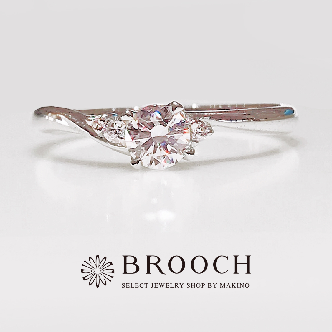 BROOCH 婚約指輪 エンゲージリング 4点留め両サイドダイヤウエーブデザイン