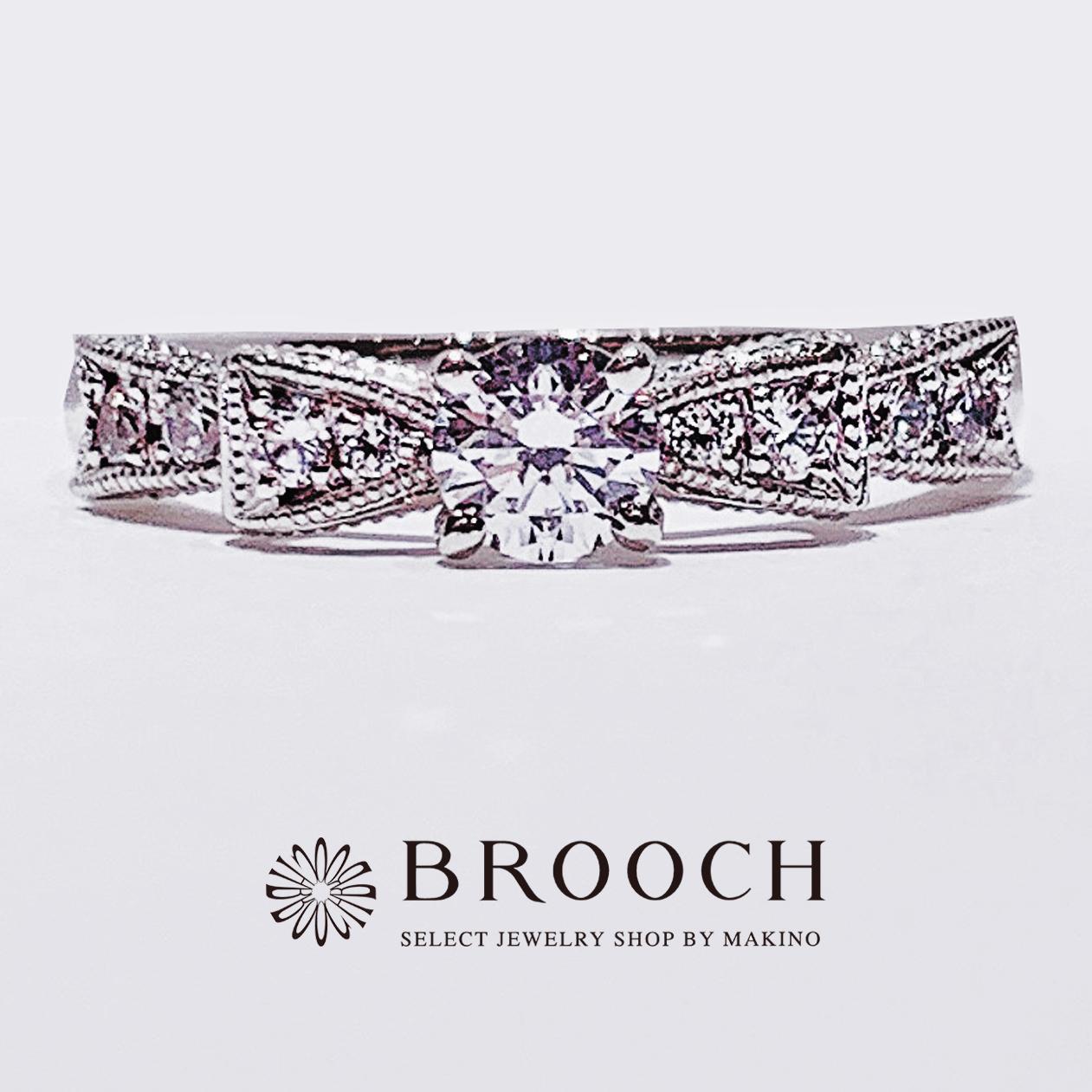 BROOCH 婚約指輪 エンゲージリング かわいい リボン型デザイン