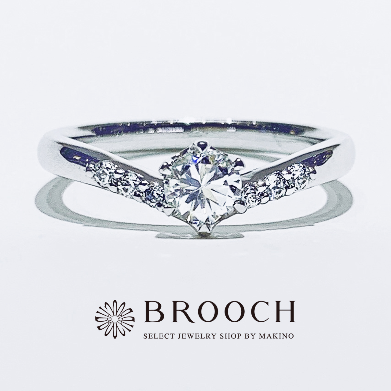 BROOCH 婚約指輪 エンゲージリング かわいい 両サイドメレV字デザイン